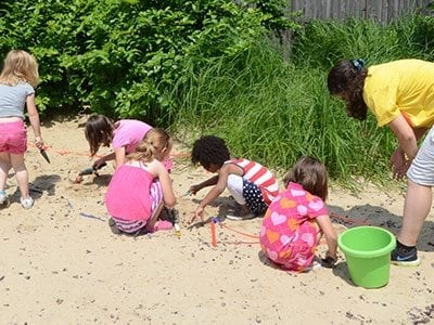 Image of a children playing in sand at Natures Neighborhood