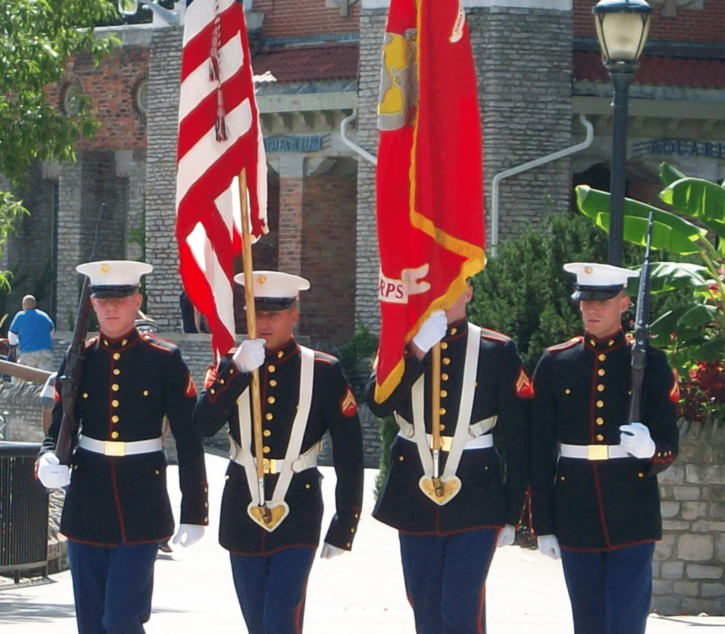 four soldiers presenting the colors at the day of honor