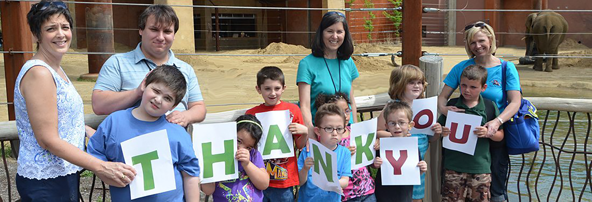 Kids holding a thank you sign for Companies for Kids